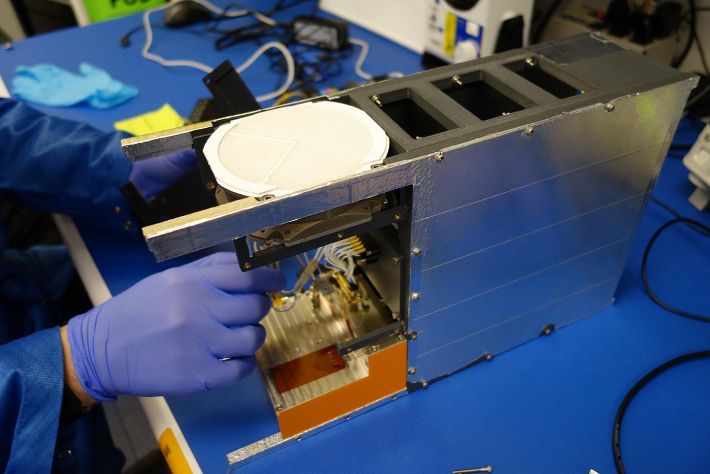 Figure 1 | A technician working on The Pony Express-1 mission payload for the Tyvak-0129, a next-generation Tyvak 6U spacecraft. Courtesy of Lockheed Martin