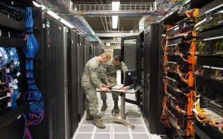 The 557th Weather Wing's system monitors the servers' overall health and provides security features such as firewalls and antivirus scans that are tailored for the specialized weather systems. (U.S. Air Force photo by Paul Shirk)