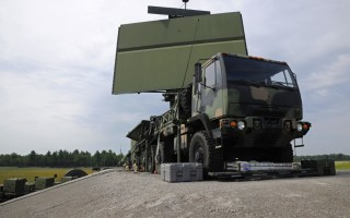"Program officials are currently utilizing the ""SpeedDealer"" strategy to acquire a production-ready, commercially available upgrade for the TPS-75 radar, pictured on a transport vehicle here. (U.S. Air National Guard photo/Senior Airman Ryan Zeski)"