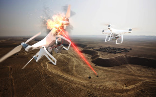 Pictured is an artist rendering of an air base air-defense scenario where high-energy lasers are used to take out enemy unmanned aerial systems (UASs). Image courtesy of Raytheon.