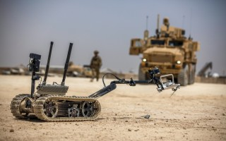 A TALON tracked military robot picks up a downed unmanned aerial system at Al Asad Air Base, Iraq, May 19, 2020. (U.S. Army photo by Spc. Derek Mustard)