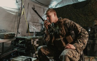 Cpl. Charles Ferris, with 1st Supply Battalion, 1st Marine Logistics Group, performs a radio check at Camp Pendleton. Photo: Joel Rivera-Camacho/Unsplash
