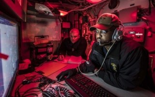 US Navy Petty Officer 3rd Class Donald Feltman acts as the system operator onboard a vessel. Photo by Navy Petty Officer 2nd Class James R. Turner.