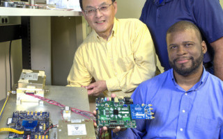 Goddard Space Flight Center?s Shing Fung (left), Mark Adrian (standing), and Damon Bradley (right) are miniaturizing a century-old technology for studying the ionosphere potentially from a constellation of CubeSats. Bradley is holding an electronics