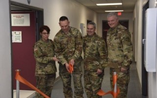 """""""] Col. Patricia Sayles, Assistant Commandant, U.S. Army Signal School; Col. Enrique Costas, Project Manager for Defense Communications and Army Transmission Systems (PM DCATS); and Col. Scott McLeod, Project Manager Training Systems (PM TRADE) look on as"""