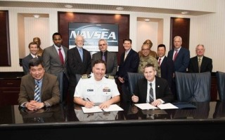 Naval Surface Warfare Center, Carderock Division Commanding Officer Capt. Mark Vandroff (center) and Technical Director (acting) Dr. Paul Shang (left) sign an Education Partnership Agreement with Dr. J. Scott Cameron (right) president of the National Inte