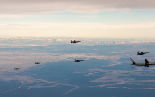 F-15Es and F-16s fly alongside a KC-46 during the Large Force Test Event 20.03. U.S. Air Force photo by 1st Lt Savanah Bray.