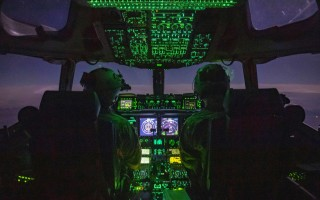 Air Force C-17 Globemaster III crew members perform routine flight duties during cargo transport operations in the U.S. Central Command area of responsibility. Air Force Staff Sgt. Taylor Harrison.