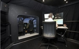 Flight-training device for military helicopters integrates tactical and visual input