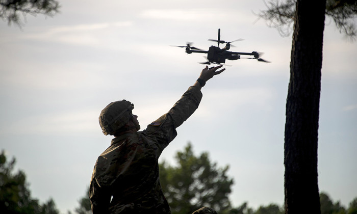 Figure 1 | A soldier hand-launches a drone during operational testing at Fort Benning, Georgia. (U.S. Army Operational Test Command photo/Tad Browning)