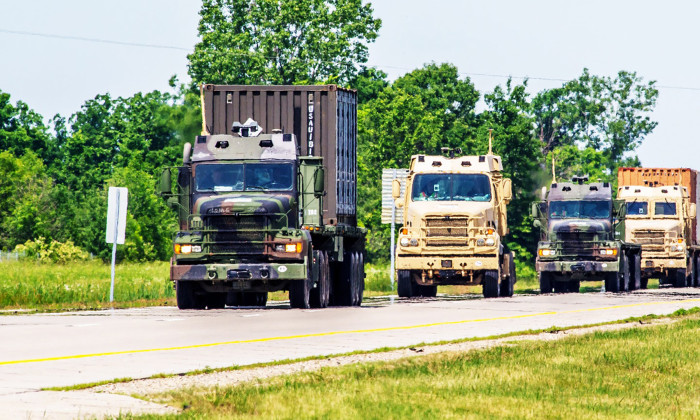 Partially autonomous or unmanned trucks shown during a U.S. Army experiment on a Michigan highway. U.S. Army photo.